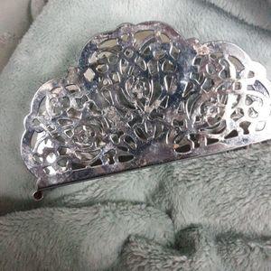 Silver colored napkin holder